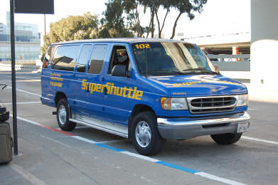 After gathering luggage at the baggage claim, follow signs for Shared Ride Van (not Ground Transportation or Shuttle), and proceed to the center island. A SuperShuttle curbside representative is available for additional assistance from AM – Midnight.